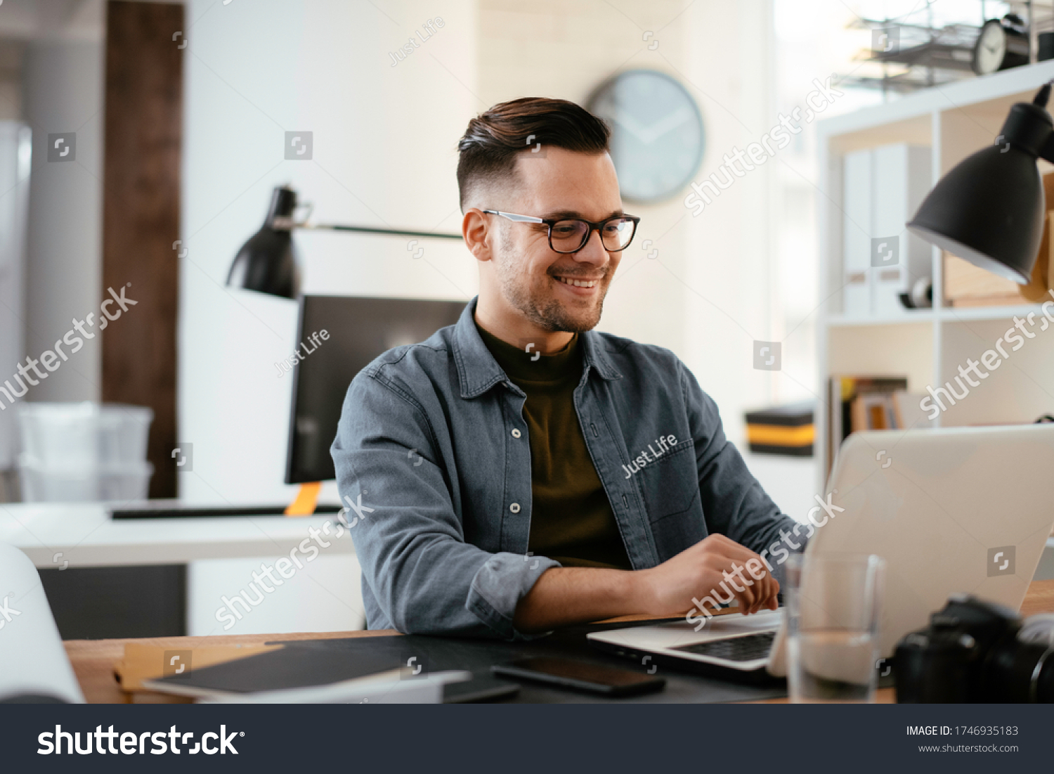 stock-photo-businessman-working-in-office-young-handsome-man-working-on-lap-top-1746935183